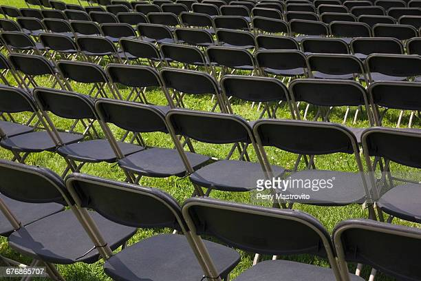 Rows of folding chairs on grass