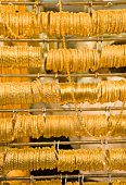 Rows of gold bracelets in Gold Souk, Deira district, Dubai, United Arab Emirates