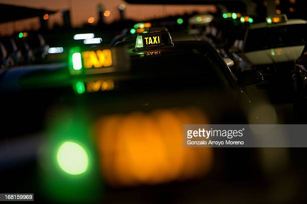 Rows of green lights on taxis at the T4 terminal taxi rank at MadridBarajas airport on April 23 2013 in Madrid Spain According to taxi association...