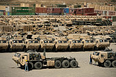 Rows of heavy vehicles and supplies at Camp Warrior, Afghanistan.