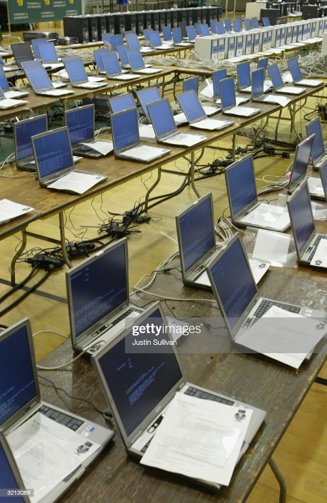 Rows of laptop computers are set up for Flashmob 1, the first flashmob supercomputer April 3, 2004 at the University of San Francisco in San Francisco, California. Hundreds of computer enthusiasts connected hundreds of computers via high-speed LAN to work together as a single supercomputer in hopes to place in the top 500 fastest supercomputers on earth.