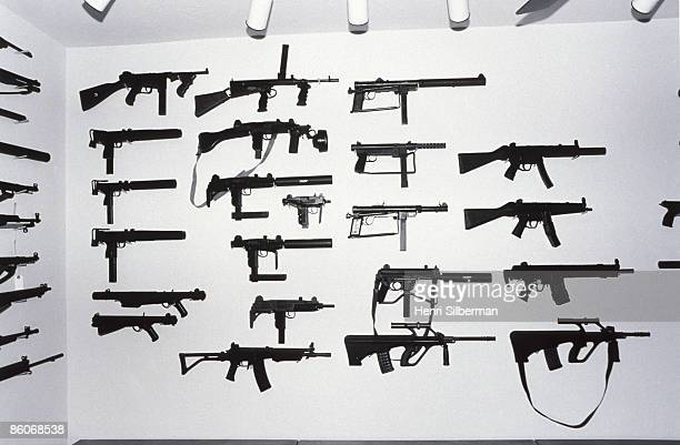 Rows of machine guns on showroom wall