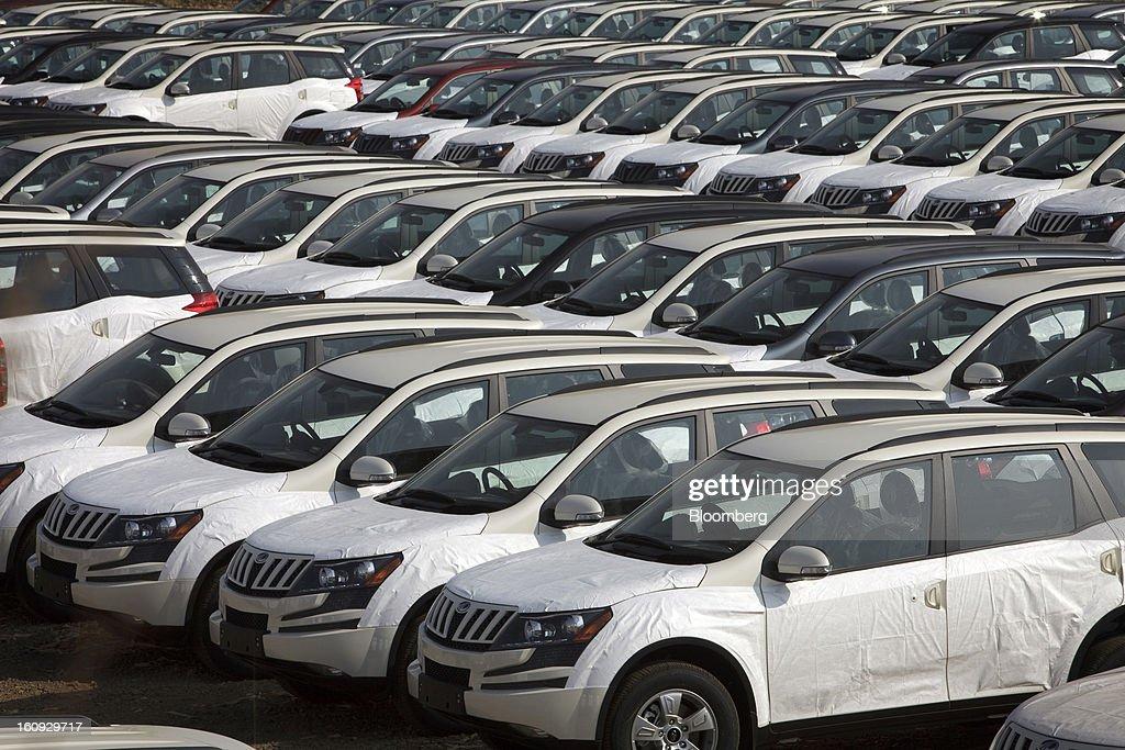 Rows of Mahindra & Mahindra Ltd. XUV 500 sport utility vehicles (SUV) are parked in a stock yard at the company's factory in Chakan, Maharashtra, India, on Wednesday, Feb. 6, 2013. Mahindra & Mahindra is scheduled to announce third-quarter earnings today. Photographer: Kuni Takahashi/Bloomberg via Getty Images