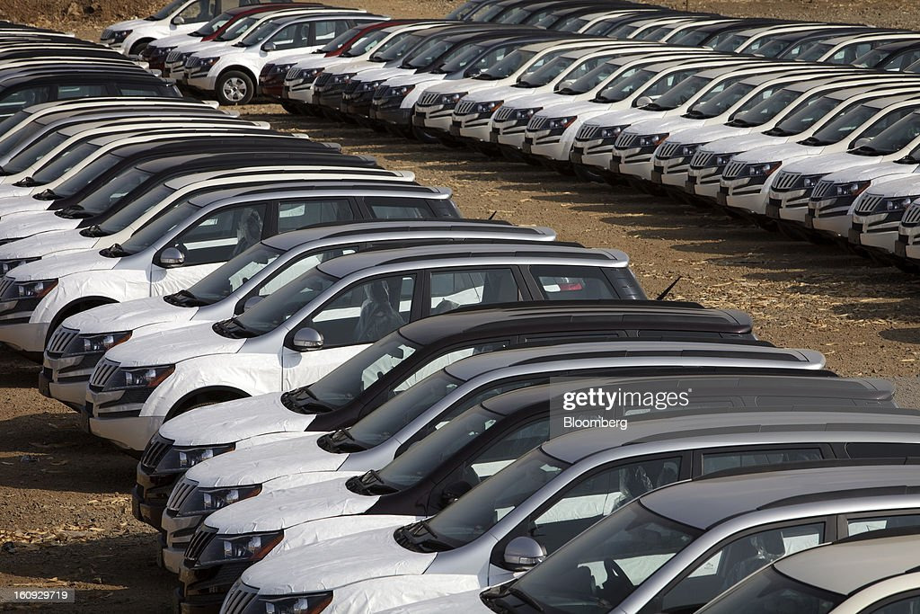 Rows of Mahindra & Mahindra Ltd. XUV 500 sport utility vehicles (SUV) are parked in a stock yard at the company's factory in Chakan, Maharashtra, India, on Wednesday, Feb. 6, 2013. Mahindra & Mahindra is scheduled to announce third-quarter earnings today. Photographer: Kuni Takahashi/Bloomberg via Getty Images