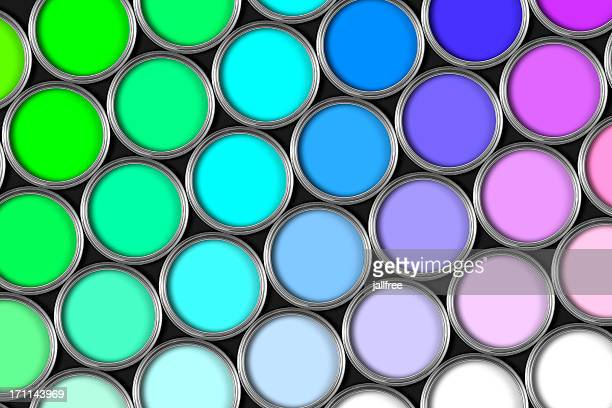 Rows of multi colored open paint tins on black