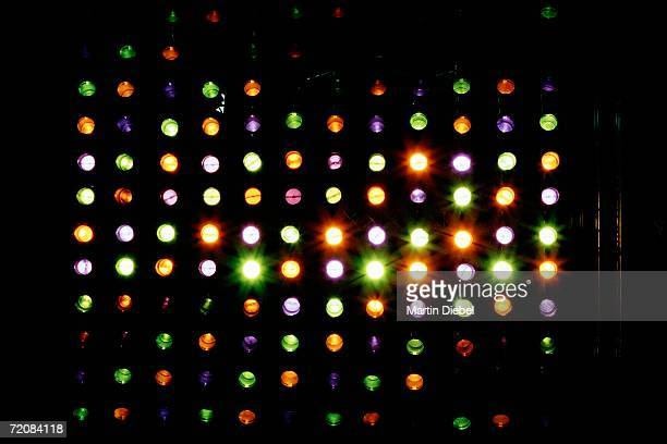 Rows of multi colored spotlights arranged in heart shape