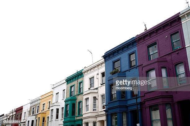 Rows of multicolored luxury residential properties stand in the Kensington and Chelsea district of London UK on Monday Aug 10 2015 Buytolet loans...