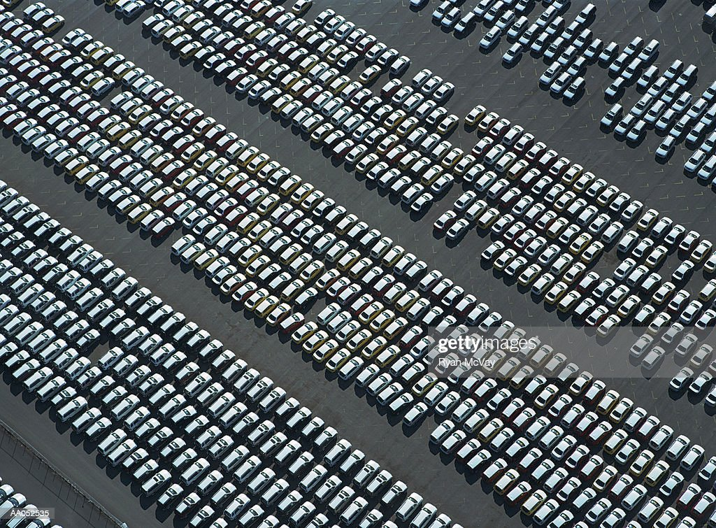 Rows of new cars parked in parking lot, aerial view : Stock Photo