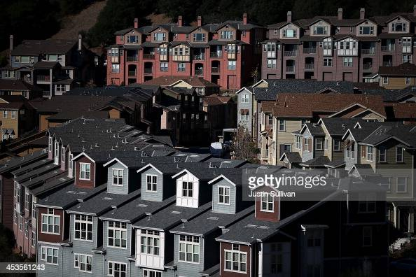 Rows of new homes line a street in a housing development on December 4 2013 in Oakland California According to a Commerce Department report sales of...