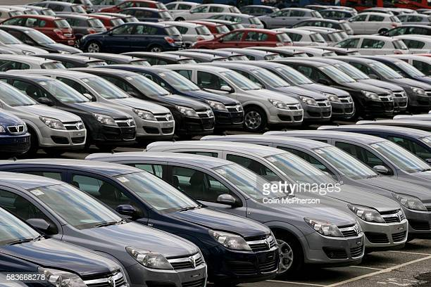 Rows of newly manufactured cars await uplift at Vauxhall Motors factory's Vehicle Distribution Centre in Ellesmere Port Cheshire northwest England...