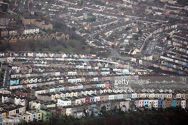Rows of painted residential houses stand in this aerial photograph taken over Bristol UK on Thursday Dec 17 2015 UK asking prices rose an annual 74...