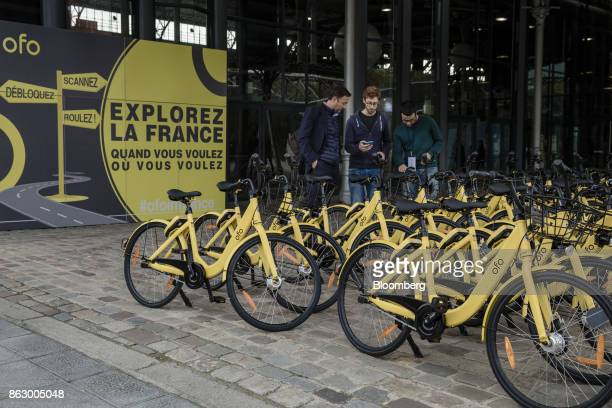 Rows of parked Ofo Inc hire bicycles stand during a presentation at the Autonomy urban mobility summit in Paris France on Thursday Oct 19 2017 Mobike...