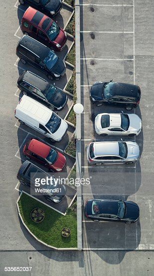 Rows of parking cars at car park, view from above