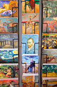 Rows of  postcards in shop.