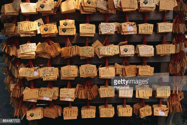 Rows of Prayer Messages Outside a Shrine