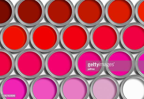 Rows of red open paint tins on white