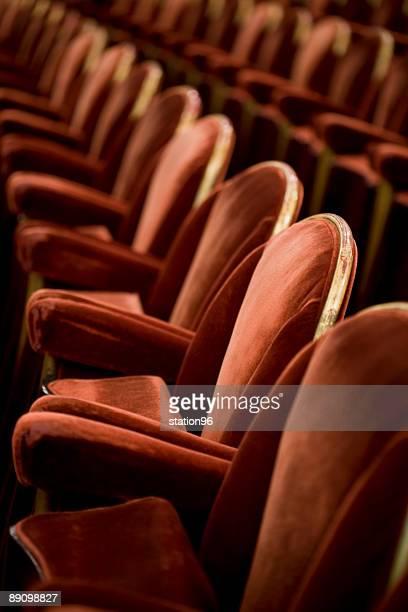 Rows of red velvet theatre seats