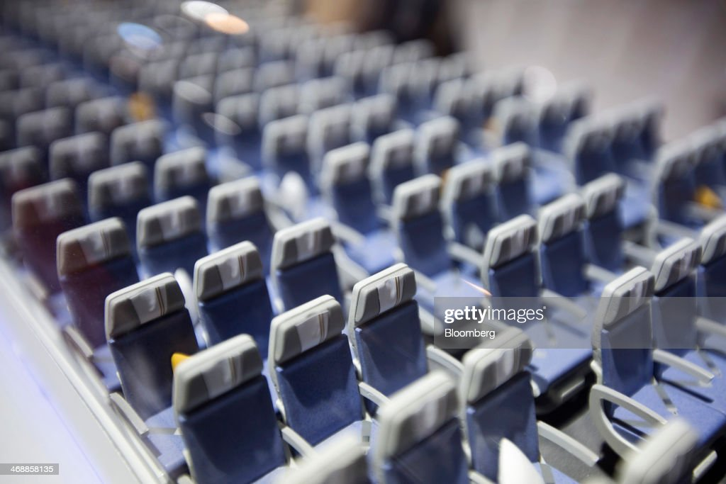 Rows of seats sit in a model of the Airbus SAS A350-900 aircraft displayed at the company's booth during the Singapore Airshow held at the Changi Exhibition Centre in Singapore, on Tuesday, Feb. 11, 2014. The air show takes place from Feb. 11-16. Photographer: Brent Lewin/Bloomberg via Getty Images