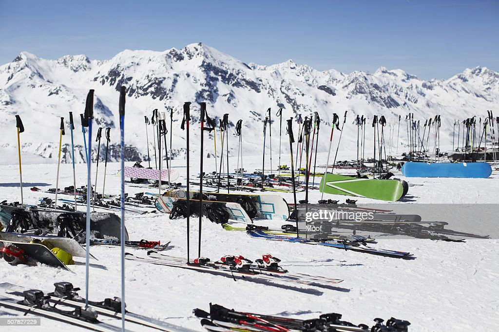 Rows of ski poles, skis and snowboards, Austria