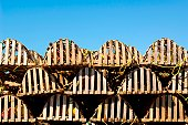 Rows of stacked lobster traps.