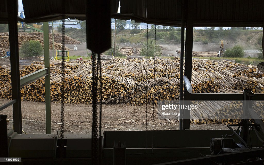 Rows of stacked logs are gathered for processing at the West Fraser Timber Co. sawmill in Quesnel, British Columbia, Canada, on Thursday, July 11, 2013. West Fraser Timber Co., the largest lumber producer in North America, had a sustainable rise in price, demand volatility, and profits within the past year. Photographer: Ben Nelms/Bloomberg via Getty Images