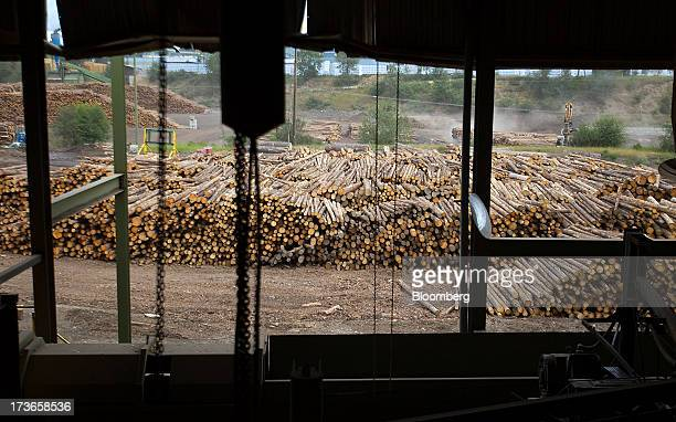 Rows of stacked logs are gathered for processing at the West Fraser Timber Co sawmill in Quesnel British Columbia Canada on Thursday July 11 2013...