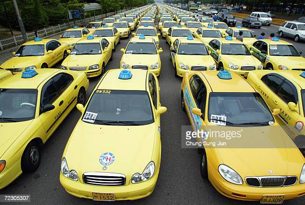 Rows of taxis block a road on June 16 2004 in Seoul South Korea Taxi drivers and metal workers went on strike to demand wage increases and better...