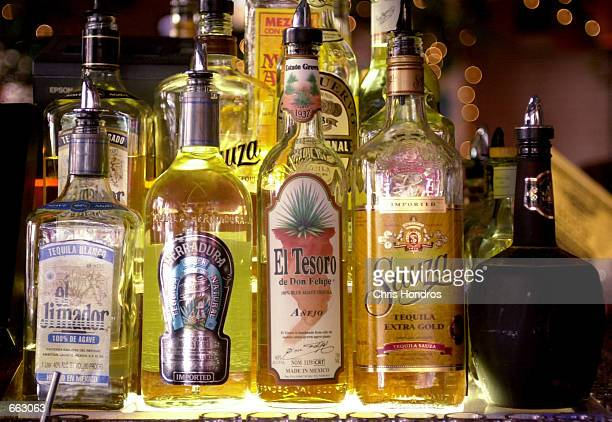 Rows of tequila bottles are on display at the Caliente Cab bar in Greenwich Village September 27 2000 in New York Up to 40 percent of the firms...