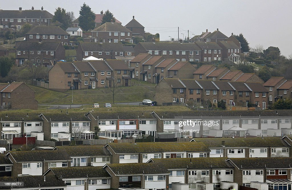 Rows of terraced residential houses stand above the town of Dover UK on Tuesday April 9 2013 An index of UK house prices rose in March as...