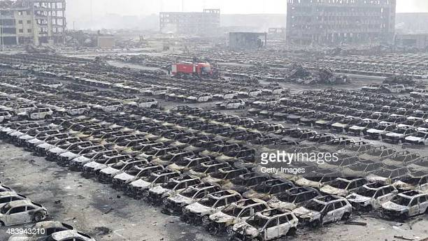 Rows of vehicles get burnt in Tianjin's warehouse explosion on August 14 2015 in Tianjin China The death toll from Wednesday warehouse explosions in...