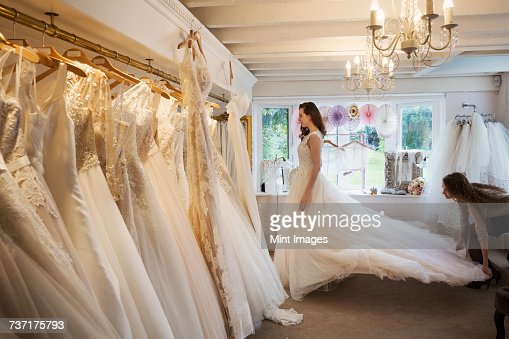 A Dressmaker Taking In A Wedding Dress Pinning And Fitting It To