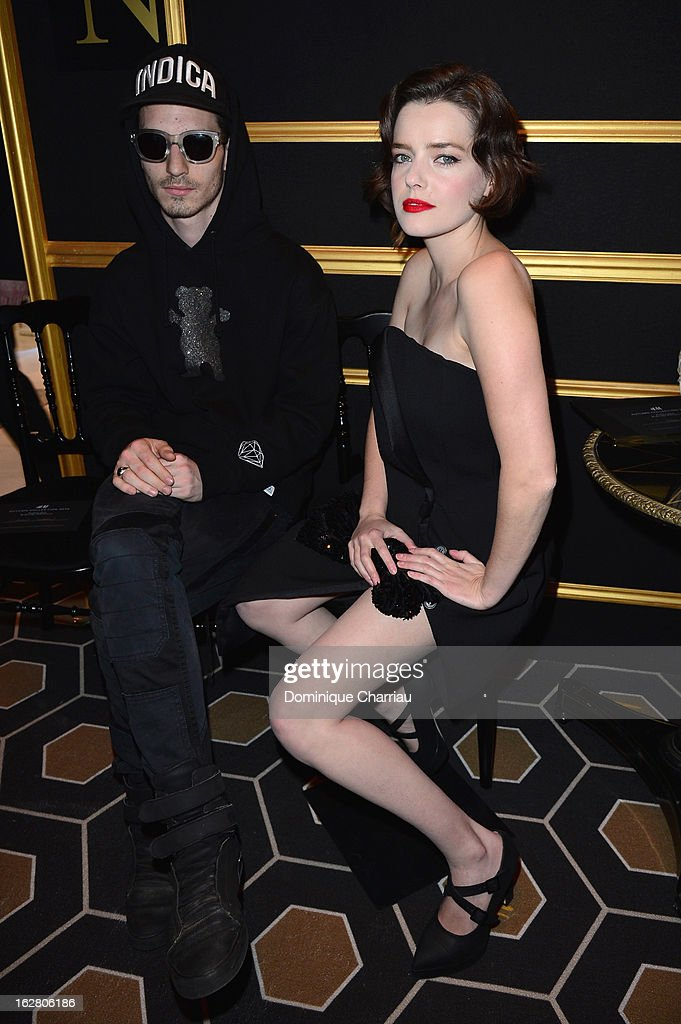 <a gi-track='captionPersonalityLinkClicked' href=/galleries/search?phrase=Roxane+Mesquida&family=editorial&specificpeople=217749 ng-click='$event.stopPropagation()'>Roxane Mesquida</a> and a friend attend the H&M Fashion Show Fall/Winter 2013 Ready-to-Wear show as part of Paris Fashion Week on February 27, 2013 in Paris, France.