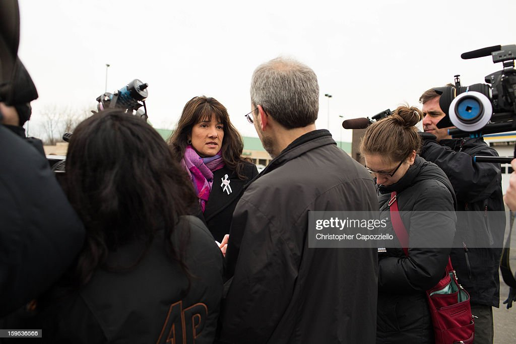 Roxanna Green, whose nine year-old daughter, Christina-Taylor, was killed at the Tucson shooting speaks with the media as protestors stand outside the Danbury Walmart January 15, 2013 in Danbury, Connecticut. Gun control advocates along with parents of victims and gun violence survivors joined together to urge Walmart, the nation's largest gun retailer to stop the sale of assault weapons and munitions in their stores nationwide.