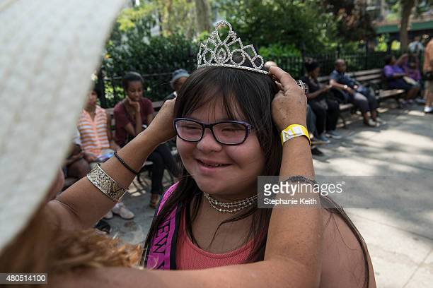 Roxanne Fernandez a 14yearold with down syndrome gets help from her Mother putting on her tiara during the first annual Disability Pride Parade on...