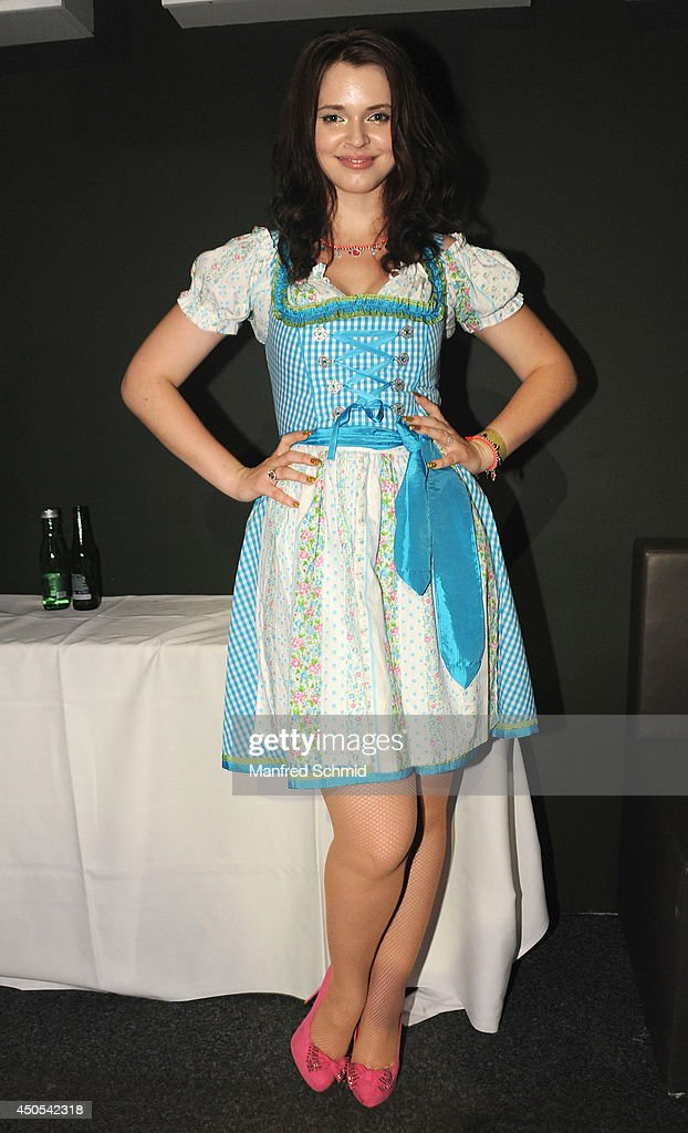 Roxanne Rapp wearing traditional Austrian outfit Dirndl poses for a photograph during the beauty competition 'Miss Wiener Wiesn-Fest 2014' at Platzhirsch on on June 12, 2014 in Vienna, Austria.