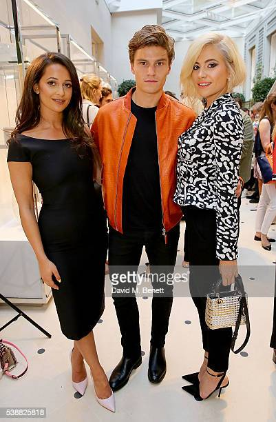 Roxie Nafousi Oliver Cheshire and Pixie Lott attend the opening of the House Of Dior on New Bond Street on June 8 2016 in London England