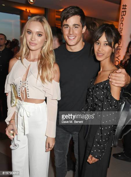 Roxy Horner Pietro Boselli and Fenn O'Meally attend the Emporio Armani You Fragrance launch at Sea Containers on July 20 2017 in London England