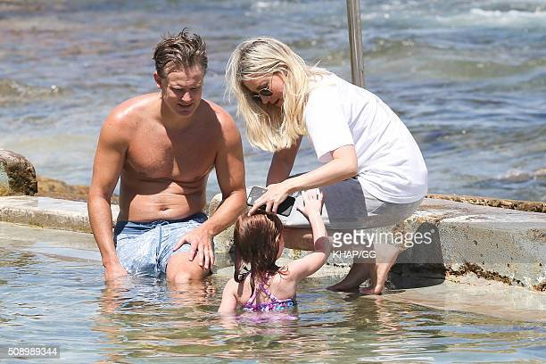 Roxy Jacenko husband Oliver Curtis and daughter Pixie enjoy a day at Bondi Beach on February 7 2016 in Sydney Australia