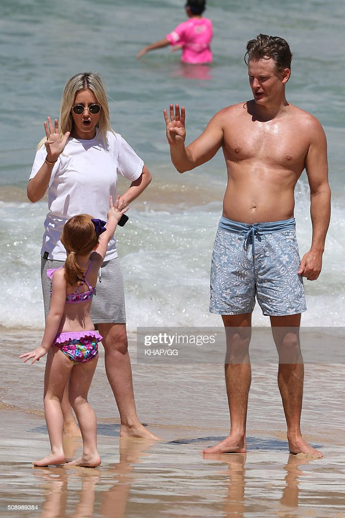 Roxy Jacenko husband Oliver Curtis and daughter Pixie enjoy a day at Bondi Beach on February 7, 2016 in Sydney, Australia.