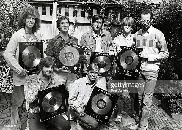 Roxy Music collecting gold discs for sales of the album Avalon at the Pullitzer Hotel Amsterdam Netherlands 5th September 1982 LR Andy Newmark Jimmy...
