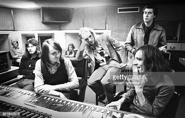Roxy Music in the control room of a London recording studio in 1972 listening to a playback Andy MacKay is far left Paul Thompson is back centre on a...