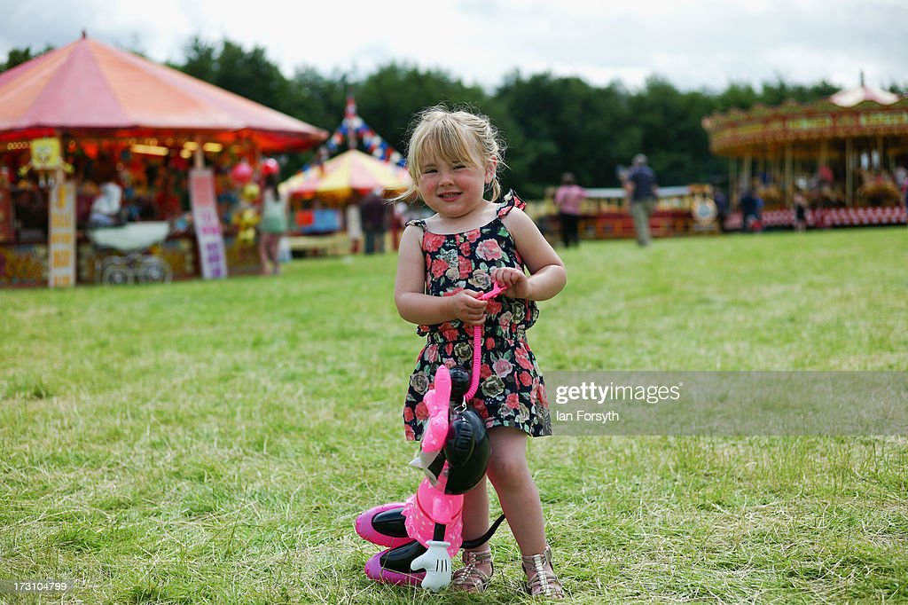 Roxy-Lee Smith, 3, from Filey enjoys the day at the steam rally at Duncombe Park on July 7, 2013 in Helmsley, England. The popular steam rally takes place in the magnificant grounds of the park over the first weekend of July each year and brings together traction engines, working displays, vintage tractors, commercial and military vehicles, vintage cars and motorcycles.