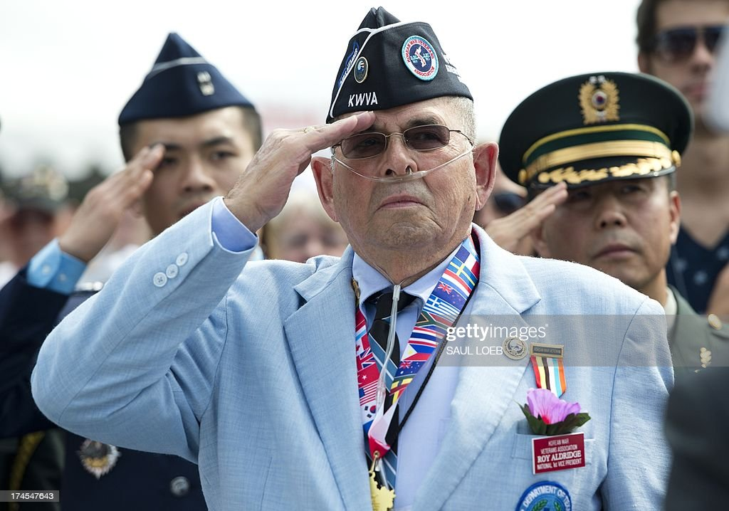 Roy Aldridge of the Korean War Veterans Association salutes during a ceremony to commemorate the 60th anniversary of the signing of the Armistice that ended the Korean War, at the Korean War Veterans Memorial in Washington, DC, July 27, 2013. AFP PHOTO / Saul LOEB