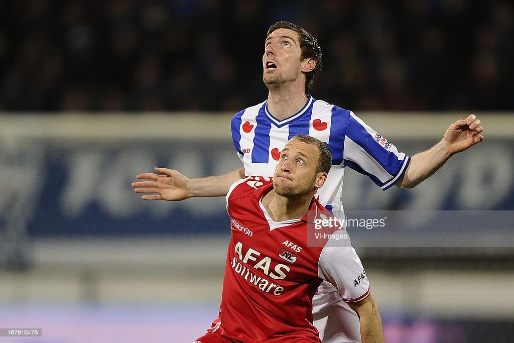 Roy Beerens of AZ, Arnold Kruiswijk of sc Heerenveen, during the Dutch Eredivisie match between sc Heerenveen and AZ Alkmaar on April 26, 2013 at the Abe Lenstra stadium in Heerenveen, The Netherlands.