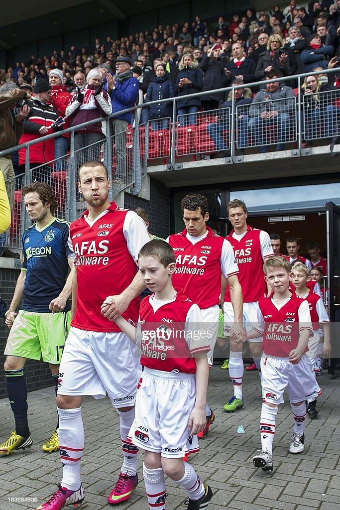 Roy Beerens of AZ, Dirk Marcellis of AZ, Viktor Elm of AZ during the Dutch Eredivisie match between AZ Alkmaar and Ajax Amsterdam at the AFAS Stadium on march 17, 2013 in Alkmaar, The Netherlands
