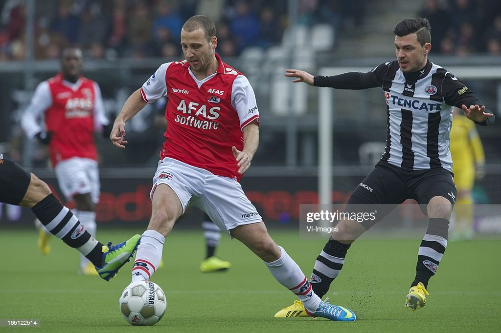 Roy Beerens of AZ, Dragan Paljic of Heracles Almelo during the Dutch Eredivisie match between Heracles Almelo and AZ Alkmaar at the Polman Stadium on march 31, 2013 in Almelo, The Netherlands