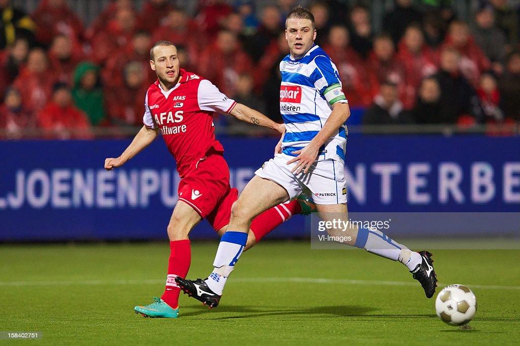 Roy Beerens of AZ, Joey van den Berg of PEC Zwolle during the Dutch Eredivisie match between PEC Zwolle and AZ Alkmaar at the IJsseldelta Stadium on December 15, 2012 in Zwolle, The Netherlands.