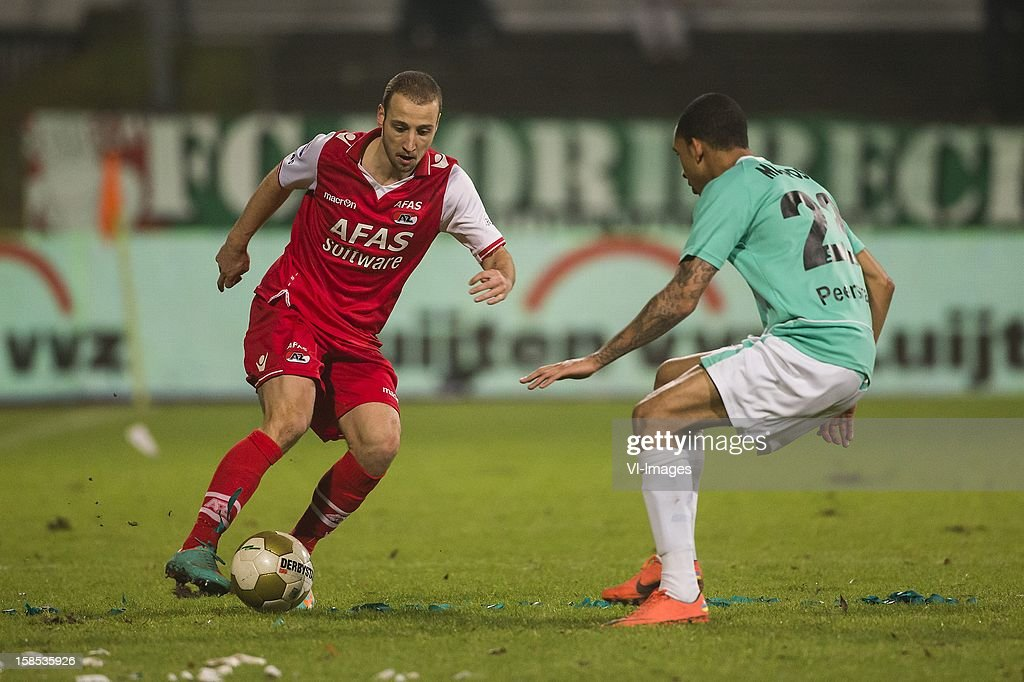 Roy Beerens of AZ, Marvin Peersman of FC Dordrecht during the Dutch Cup match between FC Dordrecht and AZ Alkmaar at the GN Bouw Stadium on December 18, 2012 in Dordrecht, The Netherlands.