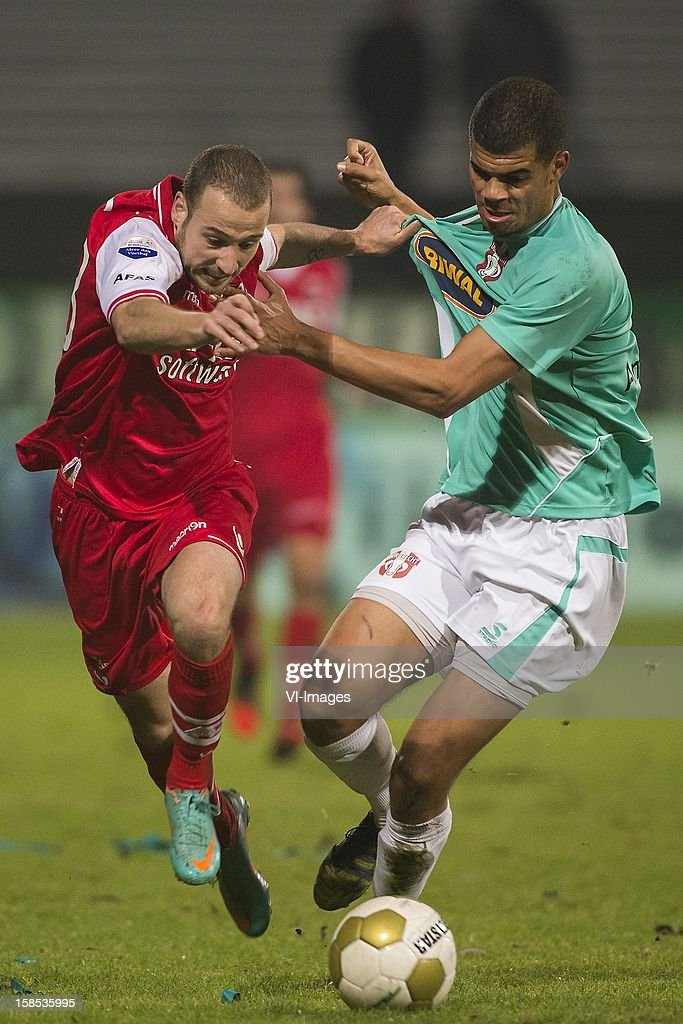 Roy Beerens of AZ, Mawouna Amevor of FC Dordrecht during the Dutch Cup match between FC Dordrecht and AZ Alkmaar at the GN Bouw Stadium on December 18, 2012 in Dordrecht, The Netherlands.