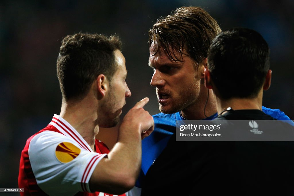 Roy Beerens of AZ points his finger in the face of Radoslav Kovac of Slovan Liberec after he reacts as referee Serhiy Boiko looks on during the UEFA...